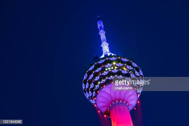 the kuala lumpur tower is a communications tower located in kuala lumpur, malaysia. its construction was completed on 1 march 1995. - shaifulzamri stock pictures, royalty-free photos & images