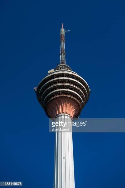 the kuala lumpur tower is a communications tower located in kuala lumpur, malaysia. - menara kuala lumpur tower stock photos and pictures