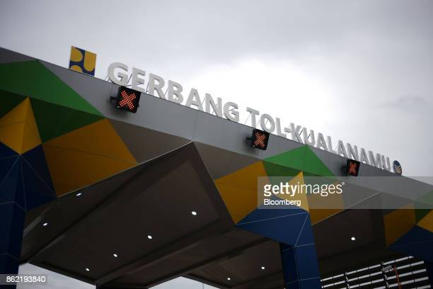 The Kualanamu toll collection gate for the MedanKualanamuTebing Tinggi toll road stands in Medan North Sumatra Indonesia on Friday Oct 13 2017...