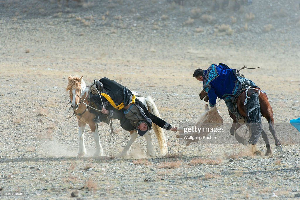 The Kukhbar competition is a traditional horseback riding game were the riders fight over a goat skin; here at the Golden Eagle Festival near the city of Ulgii (Ölgii) in the Bayan-Ulgii Province in western Mongolia.