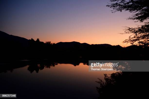 The Kunene River near the Epupa Falls at dawn, Kaokoveld, Namibia