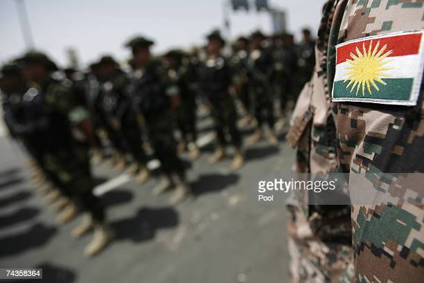 The Kurdish flag is seen on a military uniform during a handover ceremony from US forces to the Kurdish regional government May 30 2007 in the...