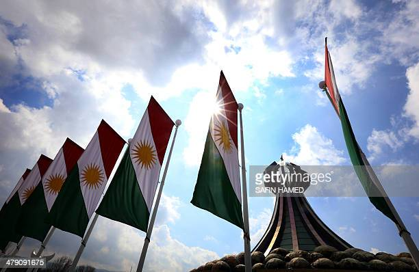 The Kurdish flags flutter close to a monument for the Iraqi Kurd victims who were killed in a gas attack by former Iraqi president Saddam Hussein in...