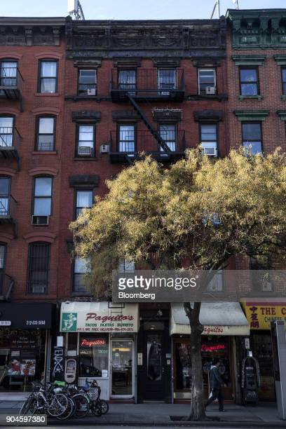 The Kushner Cos 143 1st Avenue apartment building stands in the East Village neighborhood of New York US on Sunday Dec 10 2017 Kushner Cos has a...
