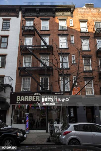 The Kushner Cos 199 East 4th Street apartment building stands in the East Village neighborhood of New York US on Sunday Dec 10 2017 Kushner Cos has a...