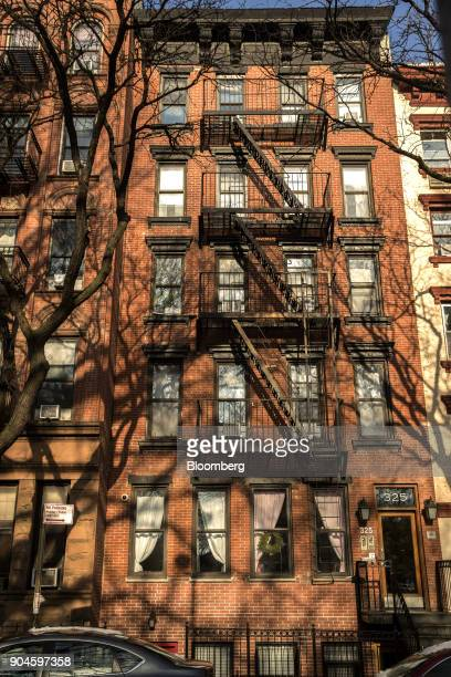 The Kushner Cos 325 East 10th Street apartment building stands in the East Village neighborhood of New York US on Sunday Dec 10 2017 Kushner Cos has...