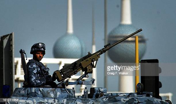 The Kuwait Towers act as a backdrop as Kuwait Security Offices watch over the streets of downtown Kuwait City As the concern of a possibility of a US...