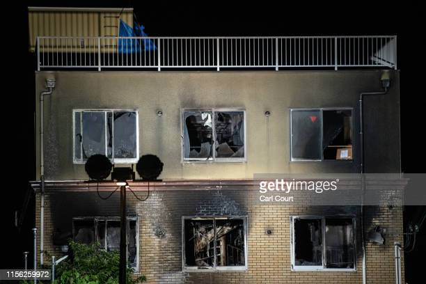 The Kyoto Animation Co studio building is pictured after being set ablaze by an arsonist on July 18, 2019 in Kyoto, Japan. Thirty three people are...