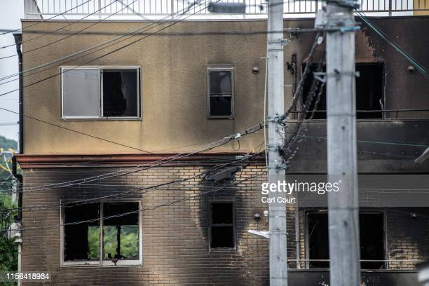 The Kyoto Animation Co studio building is pictured after being set ablaze by an arsonist on July 19, 2019 in Kyoto, Japan. Thirty three people are...