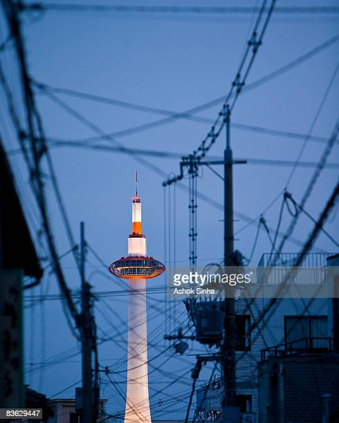the kyoto tower amidst a tangle of cables  - isolated color stock pictures, royalty-free photos & images