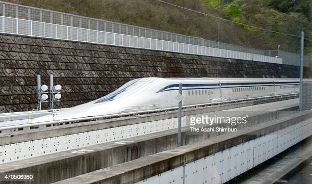 The L0 Series maglev train runs on the JR Tokai's Yamanashi Maglev Test Track shortly after hitting a record 603 kph on April 21 2015 in Tsuru...