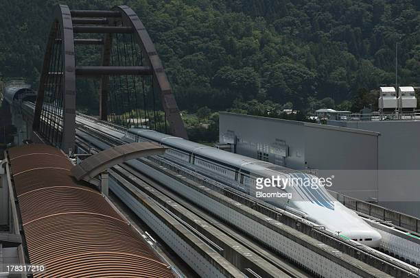The L0 series magneticlevitation train developed by Central Japan Railway Co moves along a test track near the control center during a trial run in...