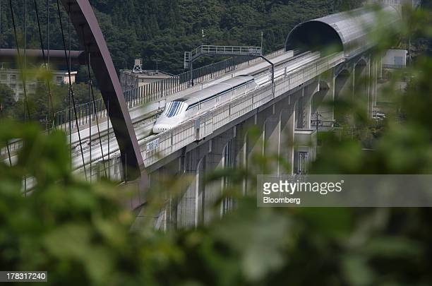 The L0 series magneticlevitation train developed by Central Japan Railway Co moves along a test track during a trial run in Tsuru City Yamanashi...