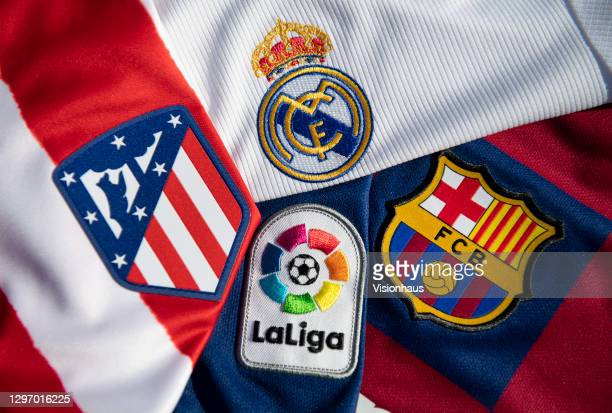 The La Liga logo with the Atlético Madrid, Real Madrid and FC Barcelona club badges on the first team home shirts on January 12, 2021 in Manchester,...