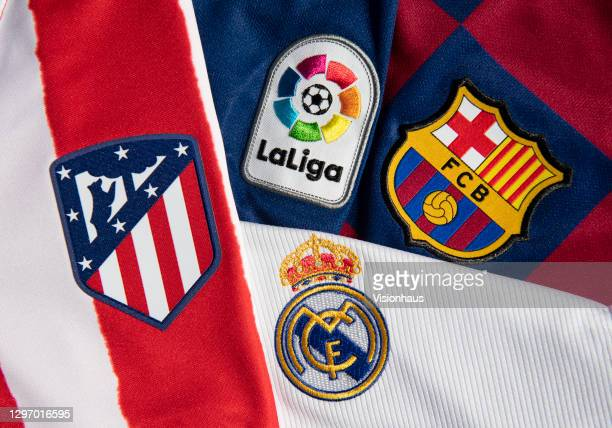 The La Liga logo with the Atlético Madrid, Real Madrid and FC Barcelona club badges on their first team home shirts on January 12, 2021 in...