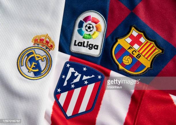 The La Liga logo with the Real Madrid, Atlético Madrid and FC Barcelona club badges on the first team home shirts on January 12, 2021 in Manchester,...