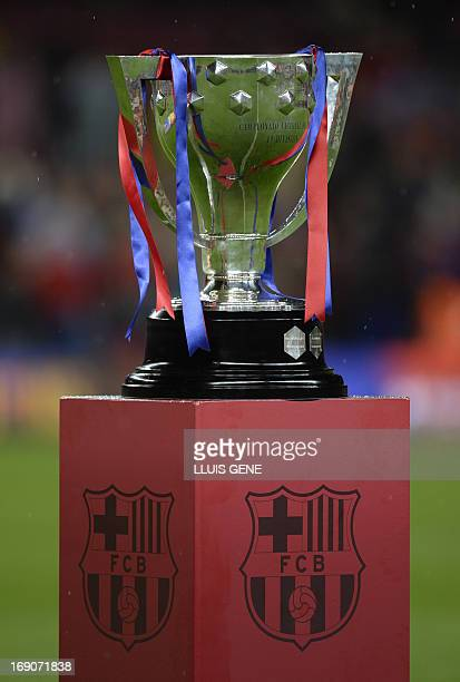 The La Liga trophy is pictured during a ceremony at the Camp Nou stadium in Barcelona on May 19, 2013. Barcelona celebrated lifting the La Liga...
