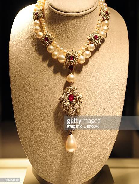 The La Peregrina Pearl suspended from Natural Pearl, Ruby and Diamond Necklace, priced between $2 000 - $3 000, is displayed during a press preview...