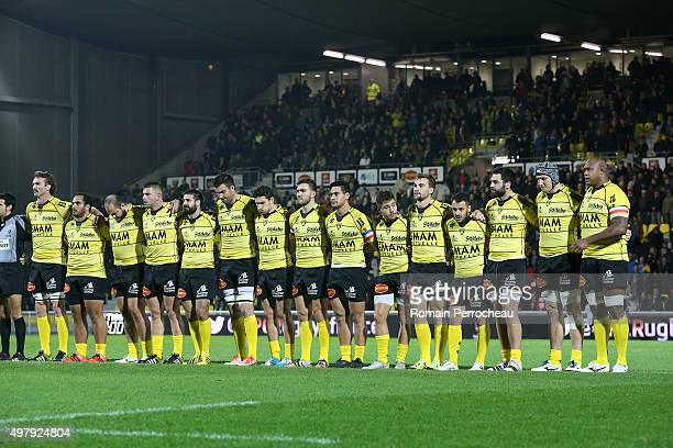 The La Rochelle team line up for a minutes silence in respect of the victims of the attrocities carried out in Paris during the European Rugby...