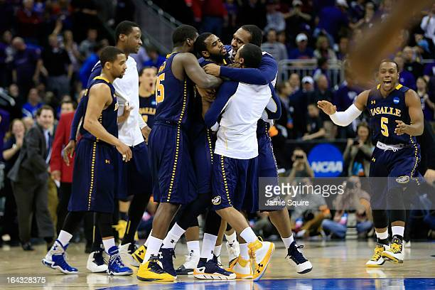 The La Salle Explorers celebrate their 6361 win over the Kansas State Wildcats during the second round of the 2013 NCAA Men's Basketball Tournament...