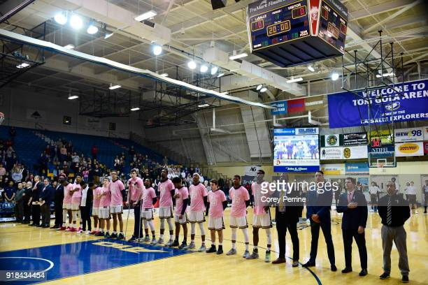 The La Salle Explorers lines up for the national anthem before the game against the St Bonaventure Bonnies at Tom Gola Arena on February 13 2018 in...