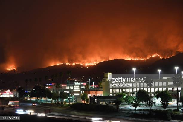 The La Tuna Canyon fire burns in the hills above Burbank California early September 2 2017 The brush fire which quickly burned 2000 acres started on...