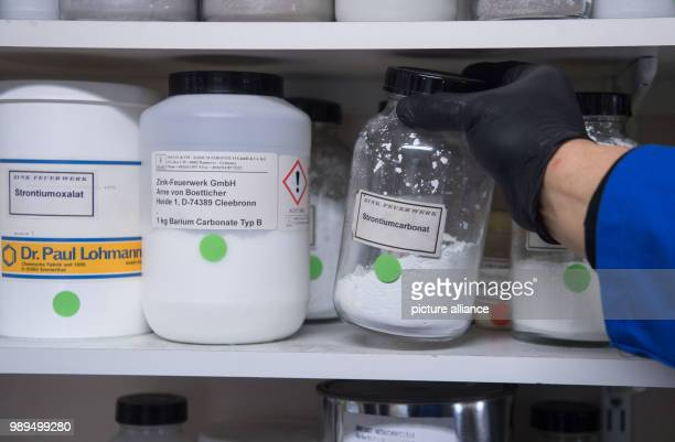 The laboratory manager of the fireworks manufacturer Zink Feuerwerk GmbH takes strontium carbonate from a shelf in Cleebronn Germany 19 December 2017...