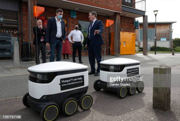 The Labour Leader Keir Starmer and Starship Technologies' VP of Marketing Henry Harris-Burlan look at Starship delivery robots at a Co-op supermarket...