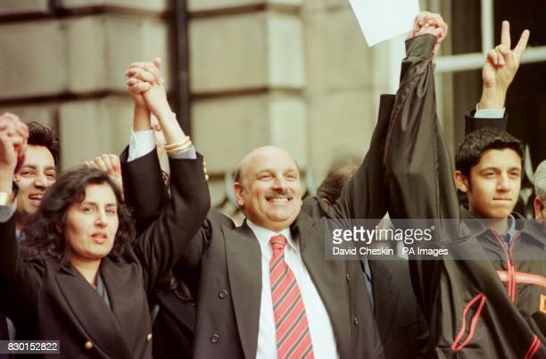 The Labour MP Mohammad Sarwar celebrates with his wife Parveen outside Edinburgh High Court after being cleared of two charges of attempting to...