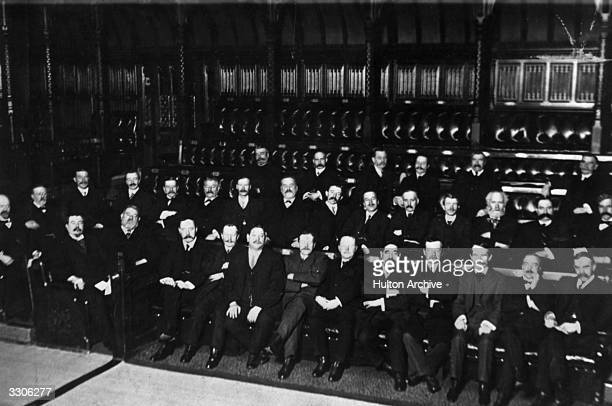 The Labour Party assembled in the House of Commons chaired by James Ramsay Macdonald the Scottish politician and first Labour prime minister who is...