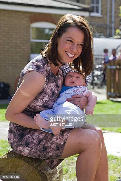 The Labour Party's prospective parliamentary candidate for Ashfield Gloria De Piero holds a baby during a visit to Stockwell Gardens Nursery on a...