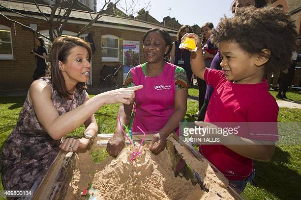 The Labour Party's prospective parliamentary candidate for Ashfield Gloria De Piero plays in a sand pit with toy cars while interacting with children...