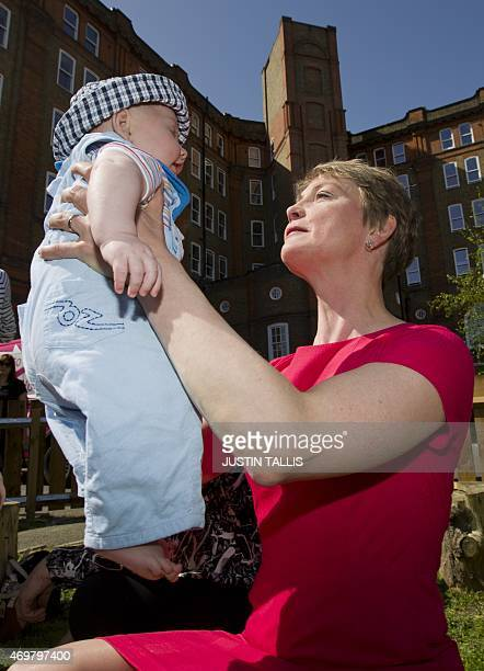 The Labour Party's prospective parliamentary candidate for Normanton Pontefract and Castleford Yvette Cooper holds a baby in Stockwell Gardens...
