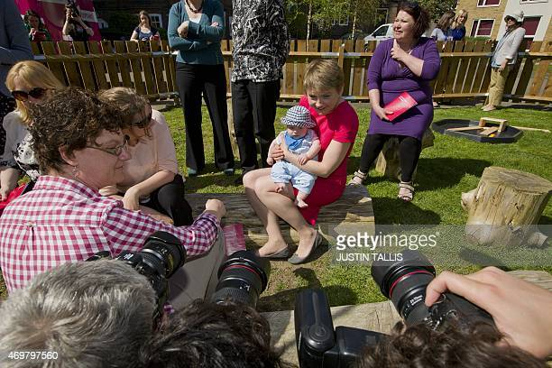 The Labour Party's prospective parliamentary candidate for Normanton Pontefract and Castleford Yvette Cooper poses with a baby during a visit to...