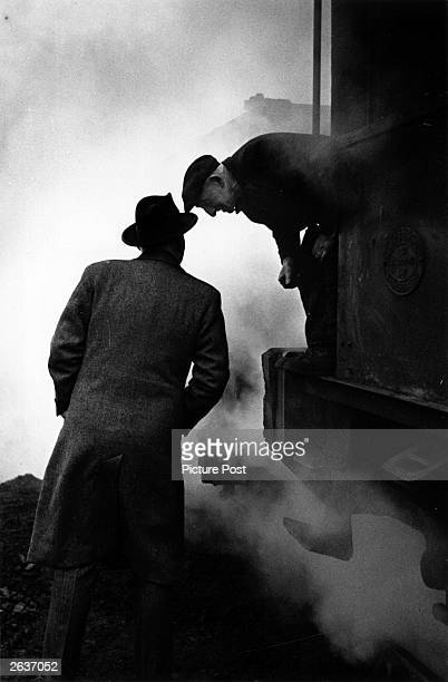 The Labour politician Hugh Dalton Baron Dalton of Forest and Frith talks to a railwayman He was a minister in Churchill's wartime coalition...