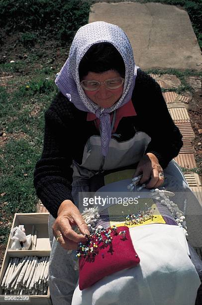 The lace maker Almagro Ciudad Real An artisan of the handmade lace carrying out their work in full street