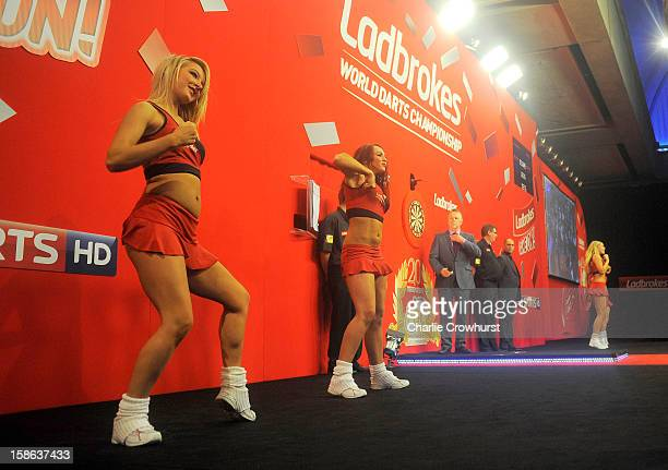 The Ladbrokes girls warm the crowd up on day nine of the Ladbrokescom World Darts Championship at Alexandra Palace on December 22 2012 in London...