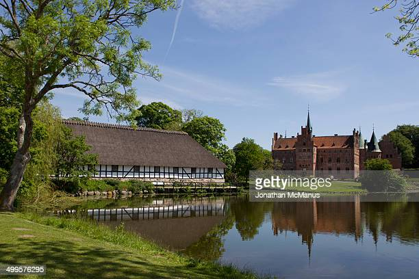 The Ladergarden and castle at Egeskov. The present castle dates from 1884 and was built under the supervision of the Swedish architect Helgo...