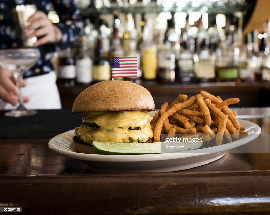 The Ladies' Burger with fries is arranged for a photograph at the Long Island Bar in the Brooklyn borough of New York, U.S., on Tuesday, April 19, 2016. Top chefs pick their all-time favorites, from burgers with fat, mid-rare patties dripping with juice to thin, crisp disks of beef smothered with cheese. These are the ones the true masters crave when they're off duty. Photographer: Eric Medsker/Bloomberg via Getty Images