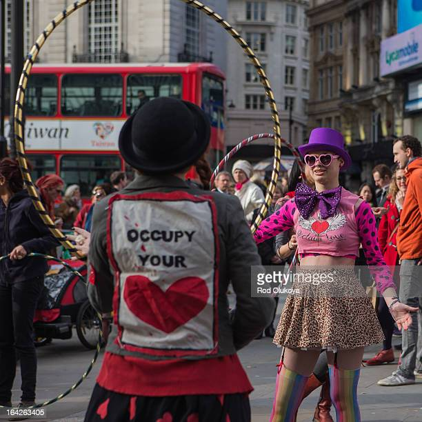 The ladies face up for Occupy Your Heart! Reclaim Love by Eros in Piccadilly, London. It is seen as a Woodstock style joyous and peaceful...