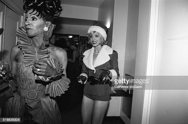 The Lady Chablis and Marla Maples dressed as Santa Claus backstage at DIFFA benefit fashion show in December 1996 in New York City, New York, United...