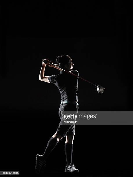 the lady golfer swings the driver of golf - 女子 ゴルフ ストックフォトと画像
