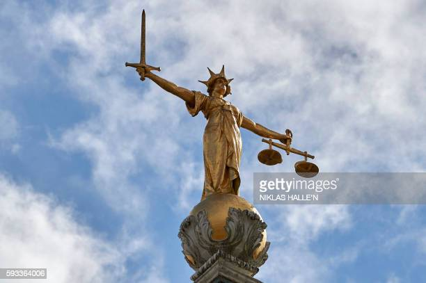 The 'Lady of Justice' a 12 foot high gold leaf statue is pictured on top of the dome of the Central Criminal Court commonly referred to as The Old...