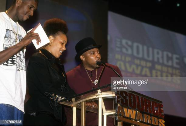 The Lady Of Rage and Nate Dogg accept an award when the Death Row Records label assembles at The Source Awards, held at The Paramount Theater at...