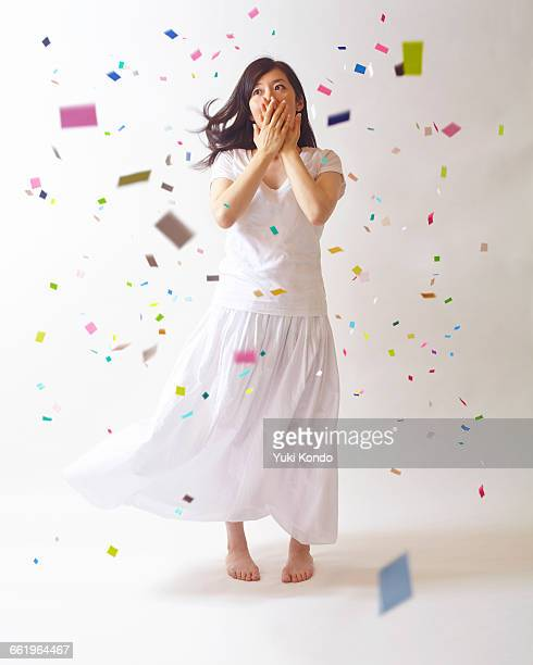 The lady surprised in the confetti.