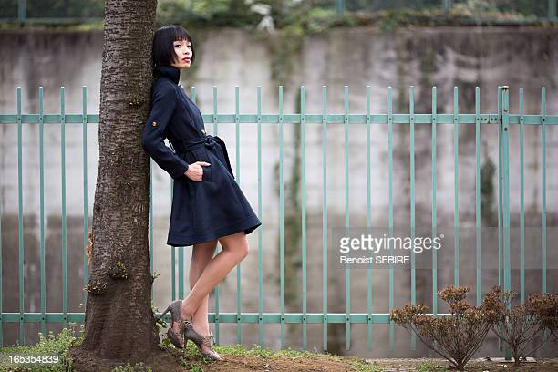 the lady under the tree - fringe dress stock photos and pictures