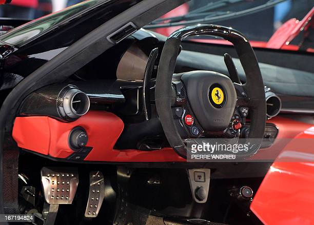 The LaFerrari car build by Italian car maker Ferrari is on display during its presentation on April 22 2013 in Paris The production of the new sports...