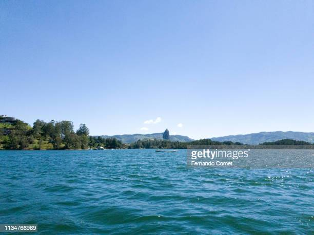 the lagoon of guatape, antioquia, colombia - guatapé stock pictures, royalty-free photos & images