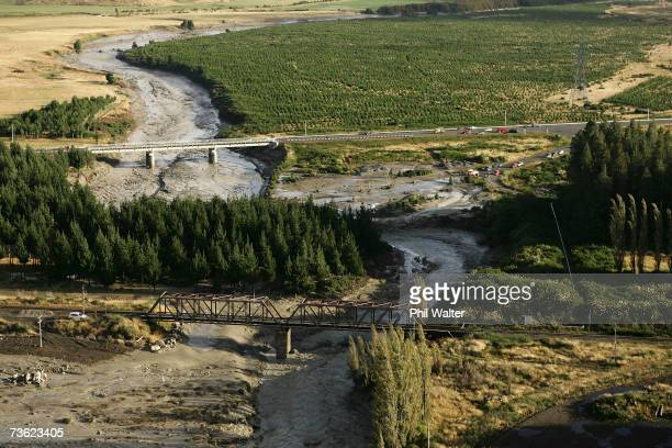The Lahar flows under the Tangiwai road and rail bridges as it makes its way along the path of the Whangaehu River after breaking the crater wall on...