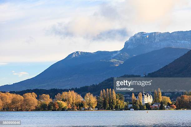 the lake and mountains of annecy in the perfect morning day - lake annecy stock photos and pictures